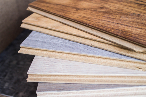 Both laminate and engineered wood are budget-friendly floor options.